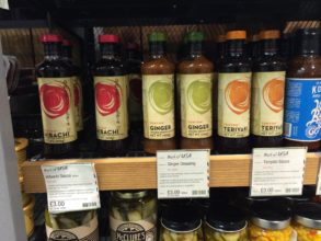 Supermarket shelf with bottles of hibichi, ginger and teriyaki sauces