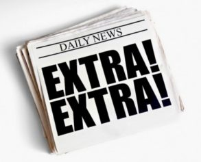 Photo of a newspaper with 'EXTRA! EXTRA!' on the front page