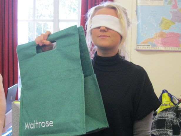 blindfolded customer with Waitrose bag