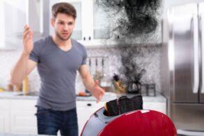 man alarmed at burning toast